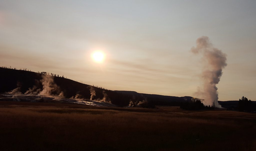 Upper Geyser Basin early in the morning. Old Faithful is erupting on the right!